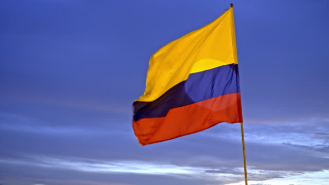 colombian flag at sunset - colombian flag stock videos and b-roll footage