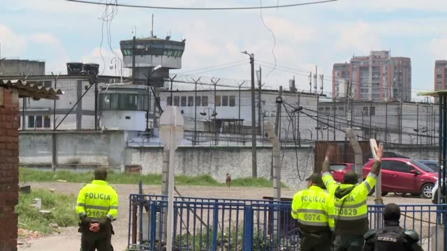 colombian police including forensics enter and exit la modelo prison in bogota after rioting swept through the crowded centre overnight and left 23... - leaving prison stock videos & royalty-free footage