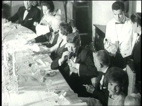 colombian president alberto lleras camargo lights a cigar for president john f. kennedy at a formal banquet at san carlos palace. - john f. kennedy us president stock videos & royalty-free footage