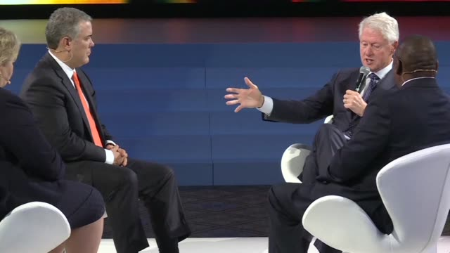 Colombian President Ivan Duque and former US president Bill Clinton discuss illegal drugs and Colombia's development at the Bloomberg Global Business...