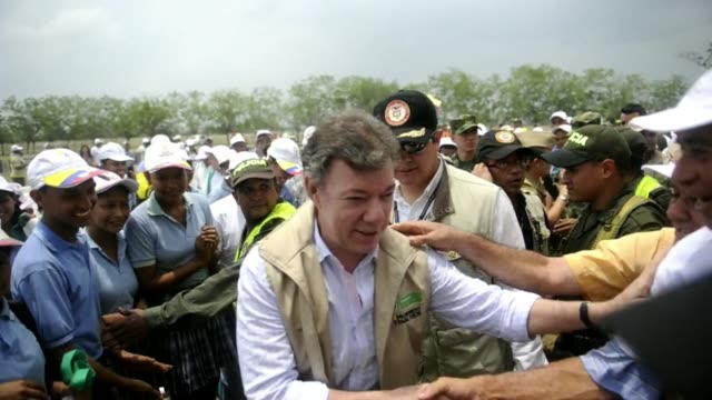 colombian president juan manuel santos formally handed over property deeds wednesday to sixty families in the north of the country who had been... - juan manuel santos stock videos & royalty-free footage