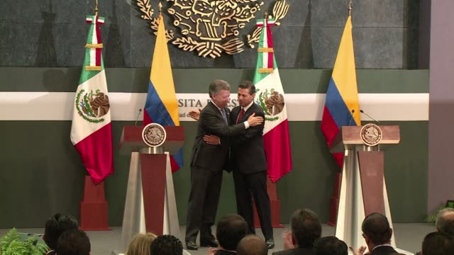 colombian president juan manuel santos is welcomed by his mexican counterpart enrique pena nieto during his two day official visit to the country - juan manuel santos stock videos & royalty-free footage