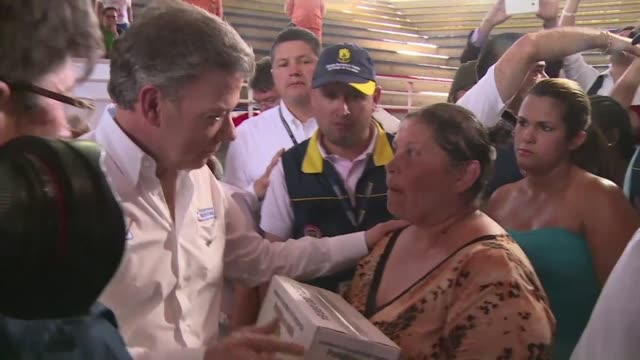 colombian president juan manuel santos visits hundreds of men and women deported from venezuela currently housed in emergency shelters set up on the... - juan manuel santos stock videos & royalty-free footage