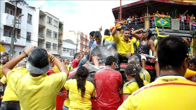 Colombian supporters flood the streets of Cali to celebrate their 21 World Cup win against Ivory Coast