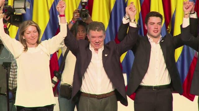 colombians re elect president juan manuel santos in a cliffhanger seen as a referendum on peace talks with farc guerrillas - juan manuel santos stock videos & royalty-free footage