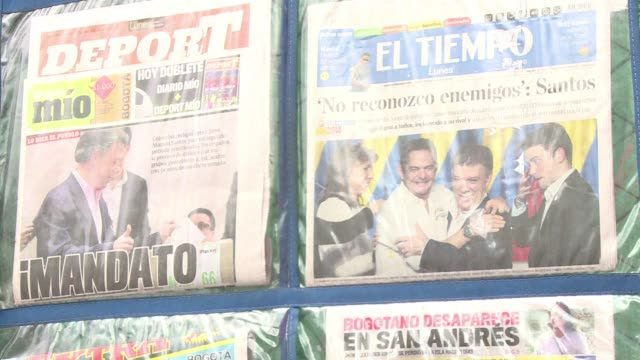 colombians re elected president juan manuel santos on sunday in a cliffhanger seen as a referendum on peace talks with farc guerrillas - juan manuel santos stock videos & royalty-free footage