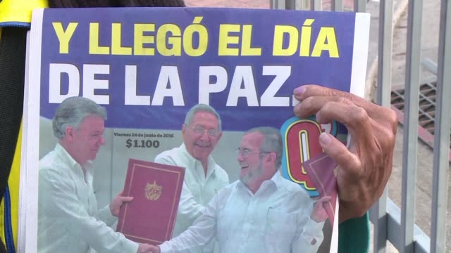 colombians woke up friday full of hope after the government and farc rebels signed a ceasefire and disarmament agreement thursday one of the last... - disarmament stock videos and b-roll footage