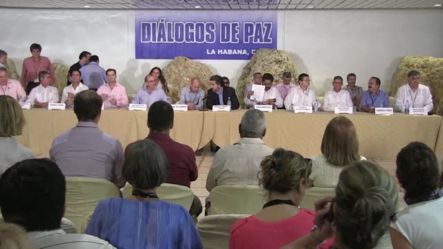 colombias government and farc guerrillas reached agreement wednesday on the rebels future participation in politics, a deal that brings the country... - politics and government stock videos & royalty-free footage