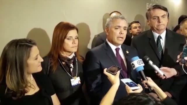 Colombia's Ivan Duque recognizes Juan Guaido as Venezuela's leader as he speaks alongside Jair Bolsonaro at the World Economic Forum in Davos