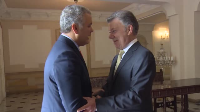 Colombia's Presidentelect Ivan Duque meets with incumbent President Juan Manuel Santos at the Casa de Narino in Bogota Colombia on June 21 2018