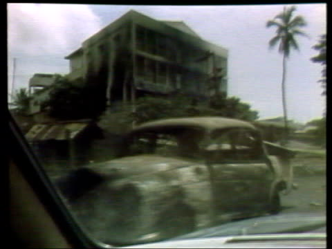 colombo: seq destroyed buildings track and smoke from burning debris during sri lanka civil war in 1983 - sri lanka stock videos & royalty-free footage