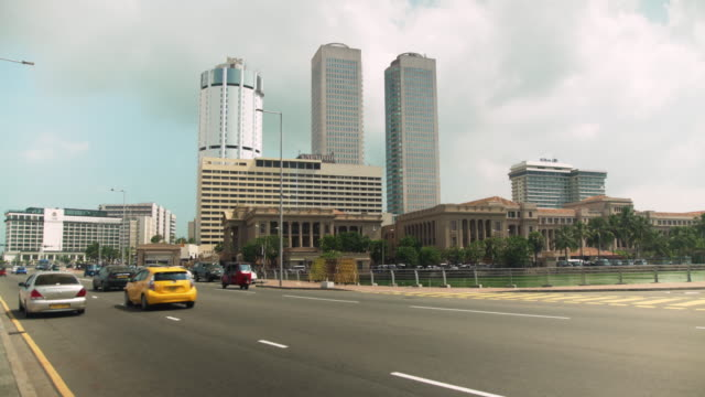 colombo sri lanka street with cars and skyscrapers skyline - newly industrialized country stock videos & royalty-free footage