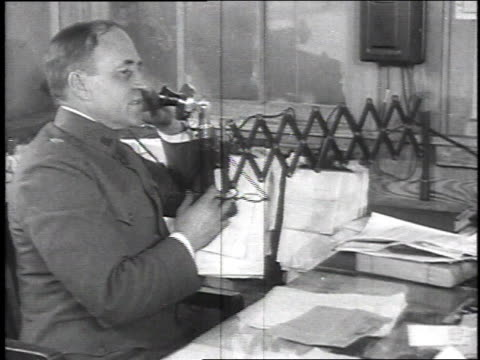stockvideo's en b-roll-footage met colonel case quartermaster sitting at desk talking on telephone / camp sherman chillicothe ohio united states - chillicothe