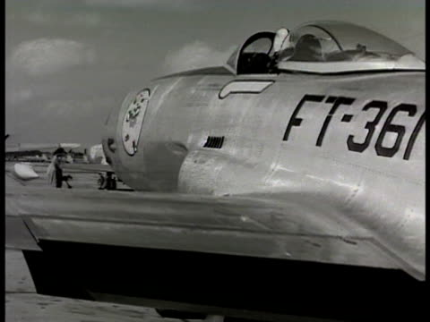 vídeos de stock, filmes e b-roll de colonel david schilling sitting in cockpit of p80 shooting star jet ms exhaust from engine tail pipe pilot adjusting wing flaps jets begin taxiing in... - 1948