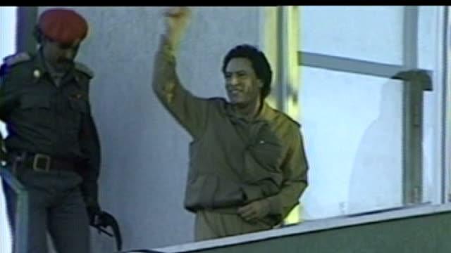analysis of Gaddafi's reign 2831986 Gaddafi down steps to balcony waving