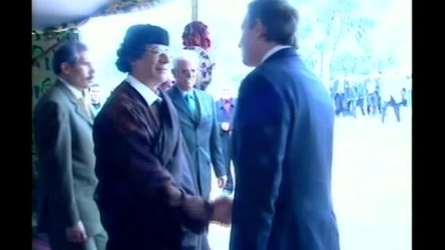 analysis of gaddafi's reign lib tony blair mp along to shake hands with gaddafi at entrance to tent - muammar gaddafi stock videos & royalty-free footage