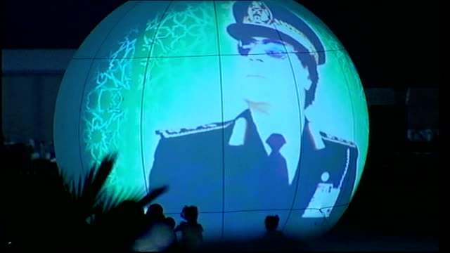 analysis of gaddafi's reign tx 192009 tripoli image of globe with image of gaddafi projected on it image of colonel gaddafi at celebration of the... - muammar gaddafi stock videos & royalty-free footage