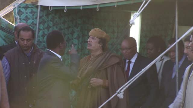 colonel gaddafi has tonight made a public appearance alongside south african president jacob zuma mr zuma rrived in tripoli as part of a delegation... - muammar gaddafi stock videos & royalty-free footage