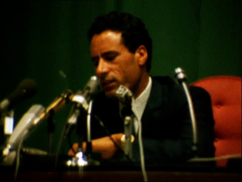 colonel gaddafi press conference:; libya: tripoli: int muammar gaddafi to mikes man in uniform beside him: khaddafi sits in chair: khaddafi: cms... - ピーター・スノウ点の映像素材/bロール