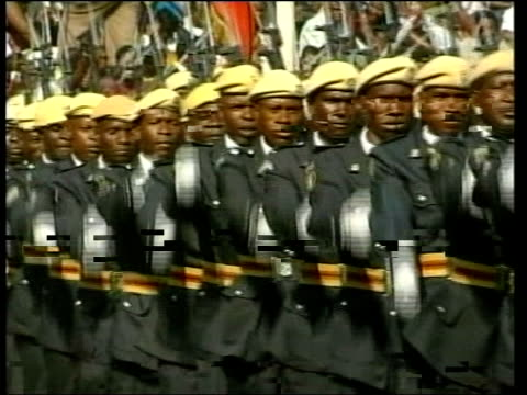 colonel gaddafi profile lib no harare ext soldiers marching during military parade to mark opening of harare agricultural show president of zimbabwe... - military parade stock videos & royalty-free footage