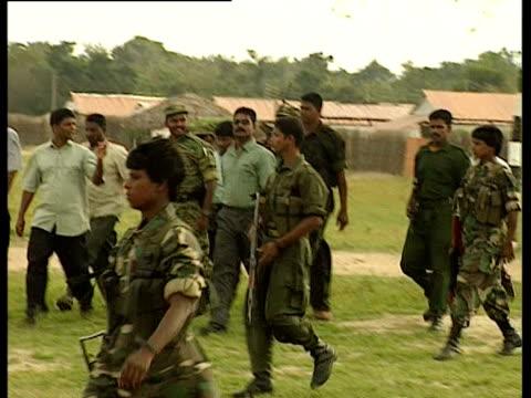 colonel karuna walks with tamil tiger soldiers. - sri lanka stock videos & royalty-free footage