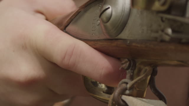 colonial soldier holding finger on trigger of musket - trigger stock videos & royalty-free footage