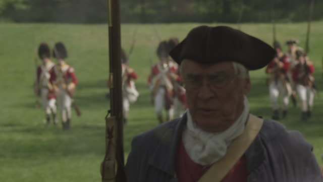colonial soldier running from british on battlefield during revolutionary war reenactment - colonial reenactment stock videos & royalty-free footage