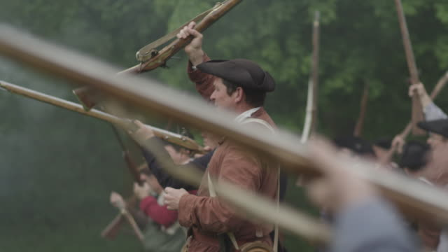 Colonial Soldiers During Revolutionary War Reenactment Raise
