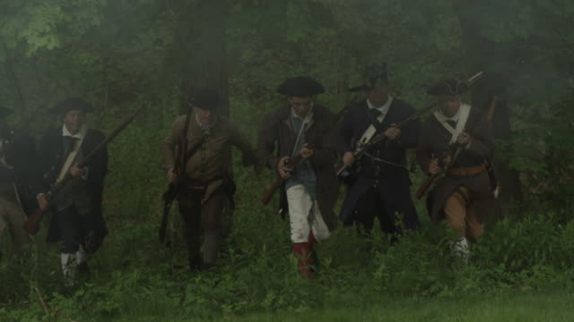 colonial soldiers running out of woods firing muskets - revolution stock videos & royalty-free footage