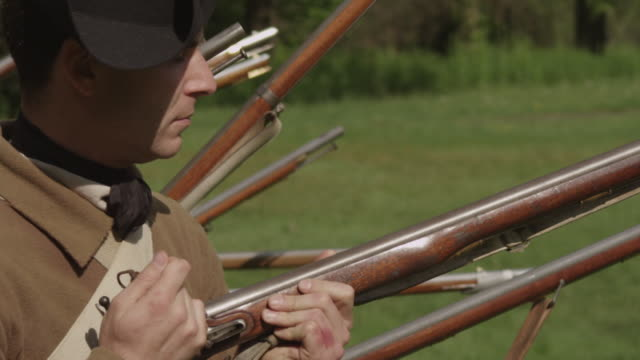 colonial soldiers standing in rows with muskets ready - colonial stock videos & royalty-free footage