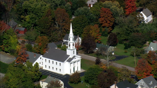 colonial style white church - aerial view - massachusetts,  worcester county,  united states - congregation stock videos & royalty-free footage
