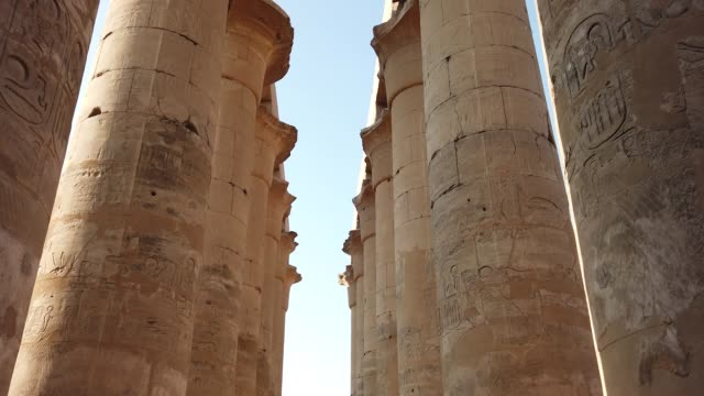 colonnade of amenhotep iii in luxor temple, egypt - statue stock videos & royalty-free footage