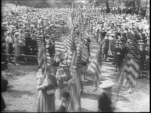 color bearers carry flags down steps of washington national cathedral / boy scouts and young girls carry flags through crowd / crowd sitting on... - young war veteran stock videos & royalty-free footage