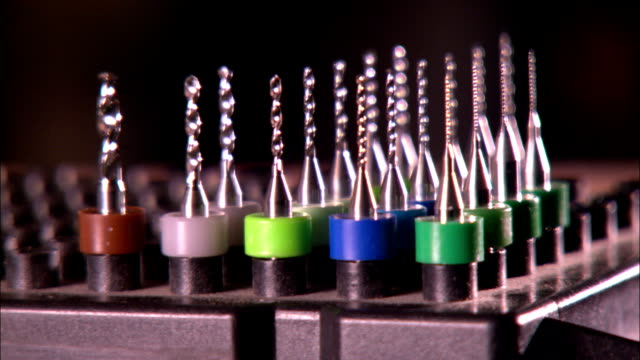 color coded drill bits are arrayed in a rack. - ドリルビット点の映像素材/bロール