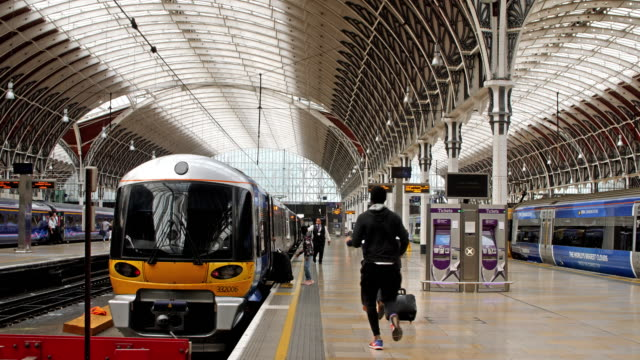 4K color footage of last passengers running to Heathrow Express at the Paddington Station London