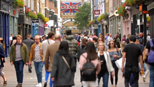 color footage of the famous carnaby street in london. - non us film location stock videos & royalty-free footage