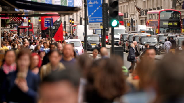 color footage of the famous regent street in london with traffic and crowds. - non us film location stock videos & royalty-free footage