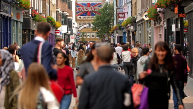 color footage of the famous shopping street carnaby in london. - busy stock videos & royalty-free footage