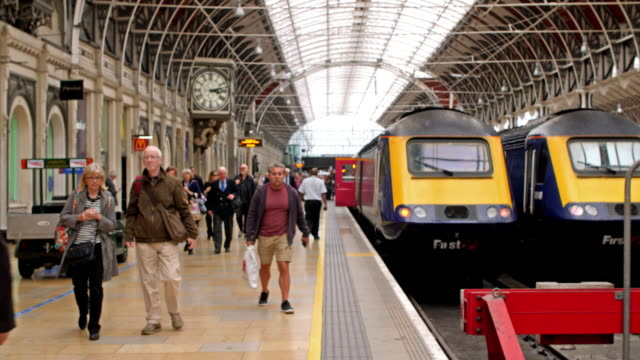 4K color footage of train passengers arriving at the Paddington Station in London