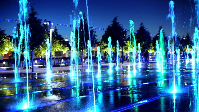 color fountain in the park at night - fountain stock videos and b-roll footage