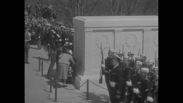 color guard follows queen juliana and prince bernhard of the netherlands as they approach the tomb of the unknown soldier in arlington, va / montage... - tomb of the unknown warrior westminster abbey stock videos & royalty-free footage