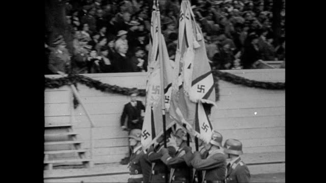 color guard marching w/ nazi swastika banners, soldiers marching 'goose step' in parade formation, jackboots marching. nazi rally: crowd giving nazi... - nazi swastika stock videos & royalty-free footage