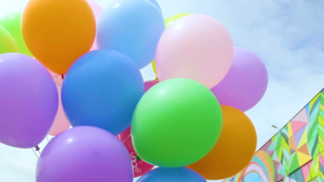 color helium balloons - balloon stock videos & royalty-free footage