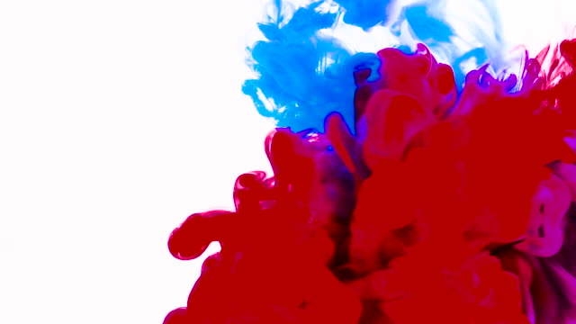 color paint drops in water in slow motion - gouache stock videos & royalty-free footage