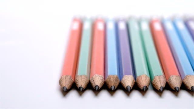 Color pencils on white background, Panning video