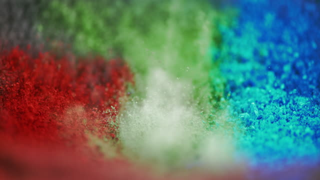 slo mo color pigments lifted into air by vibration - powder paint stock videos & royalty-free footage