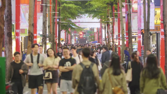 4k color video of people walking in ximending shopping district - insel taiwan stock-videos und b-roll-filmmaterial