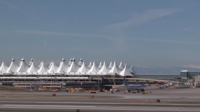 stockvideo's en b-roll-footage met colorado air national guard f-16 d lands at denver international airport in preparation for temporary operations while buckley afb receives runway... - dia