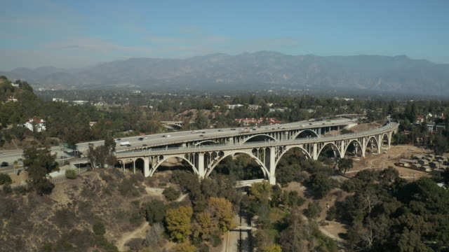 colorado bridge and 134 freeway in pasadena california - aerial shot - pasadena california stock videos & royalty-free footage