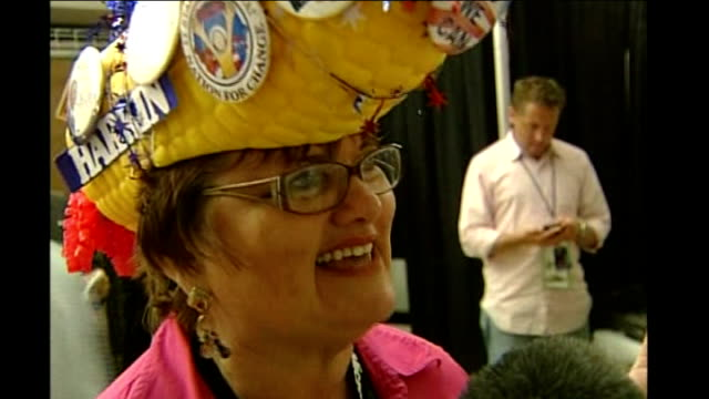 denver: int vox pops with democrat supporter wearing corn head hat covered in badges sot - she says it represents good mood in iowa celebrating... - guam stock videos & royalty-free footage